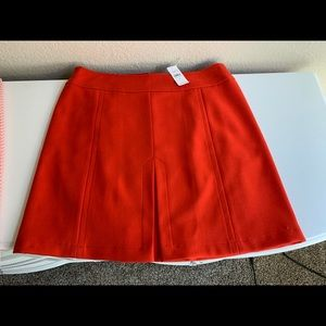 NWT Red Mid Thigh Length Skirt with front pleat.